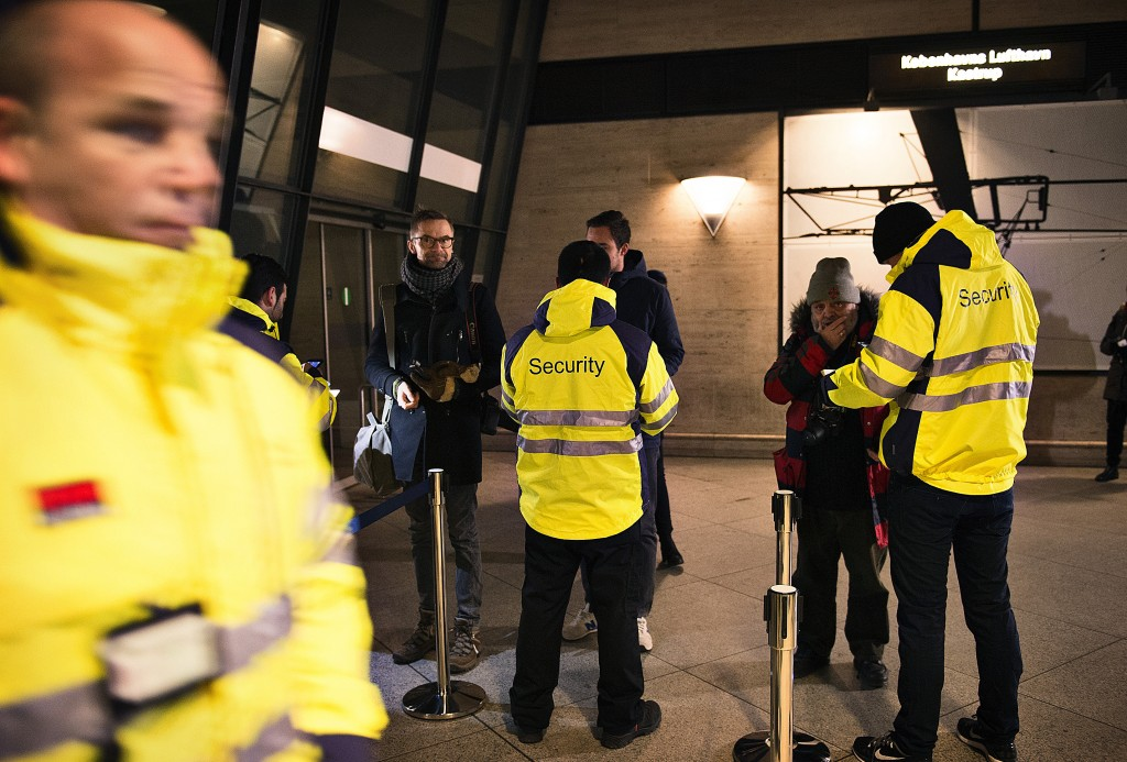 Security staff check people's identification at Kastrups train station outside Copenhagen, Denmark January 4, 2016. Border checks on train passengers aimed at curbing the number of asylum seekers entering Sweden from Denmark will cost Denmark's rail operator nearly 1 million Danish crowns ($147,000) a day, the state-owned company said late last month. Travellers have been able to cross borders between the two Nordic countries without passports since the late 1950s. But starting Jan. 4, all Sweden-bound trains will be stopped for mandatory identification checks. REUTERS/Nils Meilvang/Scanpix Denmark ATTENTION EDITORS - THIS IMAGE WAS PROVIDED BY A THIRD PARTY. FOR EDITORIAL USE ONLY. NOT FOR SALE FOR MARKETING OR ADVERTISING CAMPAIGNS. THIS PICTURE IS DISTRIBUTED EXACTLY AS RECEIVED BY REUTERS, AS A SERVICE TO CLIENTS. DENMARK OUT. NO COMMERCIAL OR EDITORIAL SALES IN DENMARK. NO COMMERCIAL SALES.