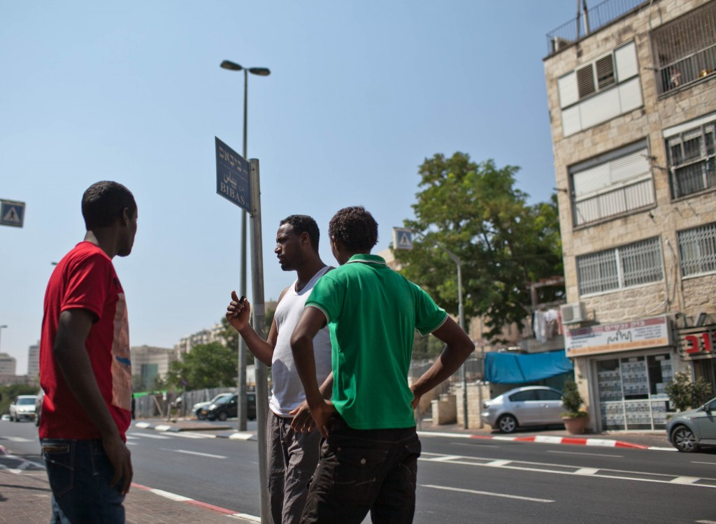A Group of young Eritrean people close the house which was set on fire In a suspected arson attack in an apartment in Jerusalem inhabited by foreign workers, leaving three people injured. Photo by Noam Moskowitz/ Flash90 *** Local Caption *** שריפה עובדים זרים אריתריאה גזענות אש תקיפה