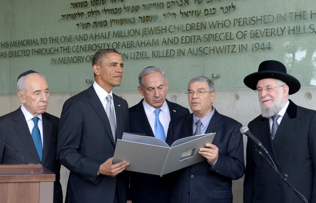 U.S. President Barack Obama visits the children's memorial at the Yad Vashem Holocaust museum with (L-R) Israel's President Shimon Peres, Israel's Prime Minster Benjamin Netanyahu, Chairman of the Yad Vashem Directorate Avner Shalev and Rabbi Yisrael Meir Lau during a visit to Yad Vashem at Mount Herzl on March 22, 2013 in Jerusalem, Israel. Photo by Moshe Milner/GPO/Flash90