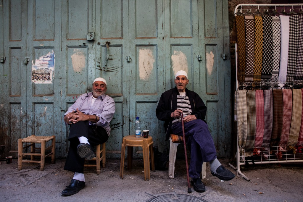 Arab shopkeepers in the Old City. Photo by Neal Badache/Flash90