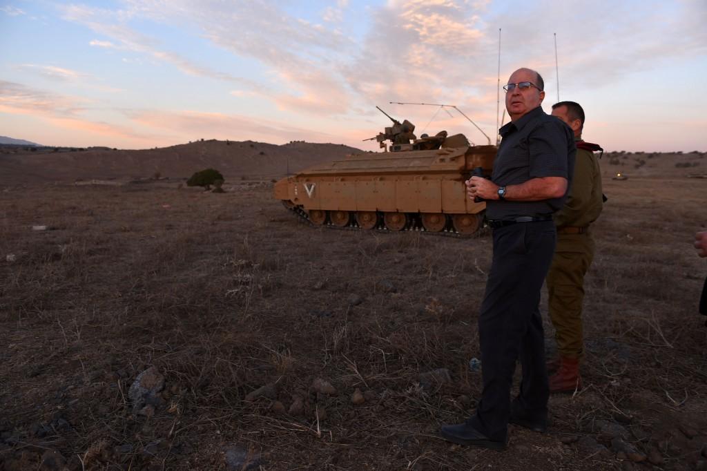 """Israeli defense minister Moshe """"Boogie"""" Ya'alon seen as he visits at an army exercise of the Armored Corps, in the Golan Heights on October 22, 2015. Photo by Ariel Hermoni/Ministry of Defense *** Local Caption *** á úøâéì çèéáú ùøéåï øîú äâåìï öáà öä''ì ùø äáèçåï îùä éòìåï áåâé çééìéí"""