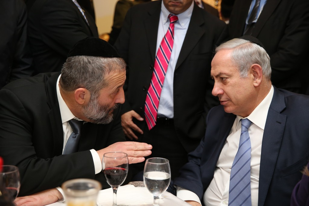"Aryeh Deri, leader of the ultra orthodox Jewish Shas party, seen with Israeli Prime Minister Benjamin Netanyahu at the ""Sheva Brachot"" of Deri's daughter, who was married earlier this week in Jerusalem. Sheva Brachot- ""the wedding blessings"", in Jewish law are blessings that are recited for a bride and her groom. December 23, 2015. Photo by Yaacov Cohen/FLASH90 *** Local Caption *** ùáò áøëåú ìáú ùì ãøòé àøéä ù''ñ ùñ øàù äîîùìä áðéîéï ðúðéäå áéáé"