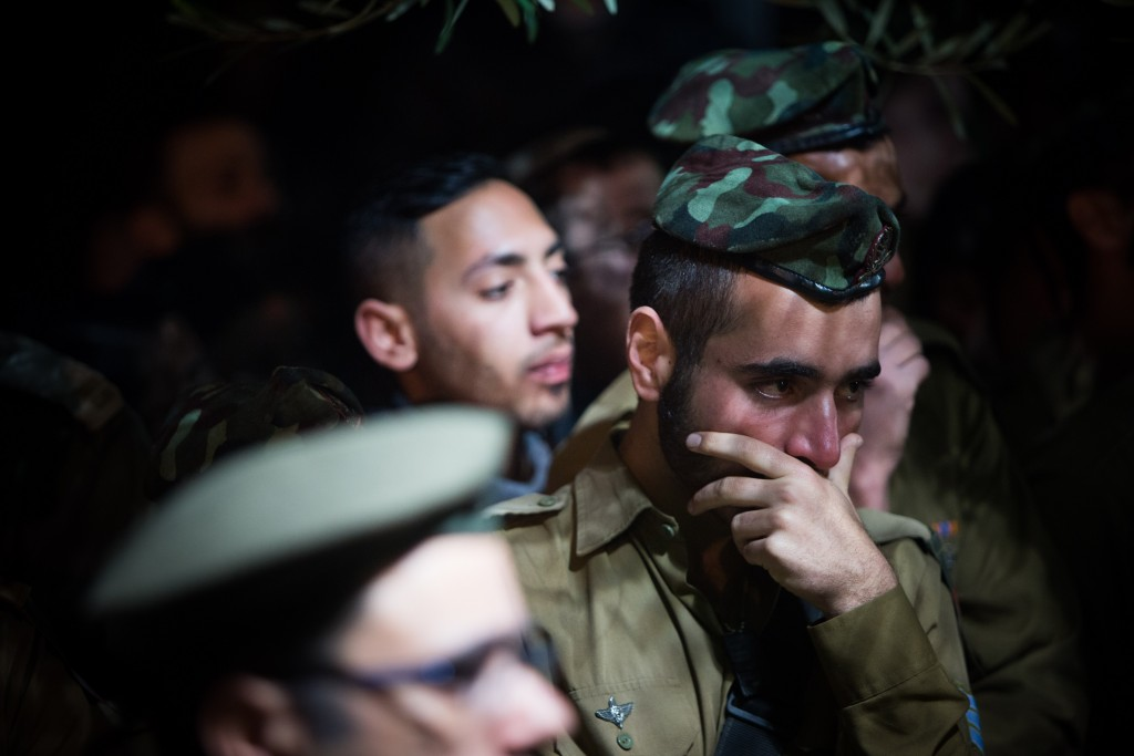 Friends and relatives mourn during the levayah of Cpt. Yishai Rosales, at Mount Herzl Military Cemetery in Jerusalem, on January 7, 2015. Photo by Yonatan Sindel/Flash90