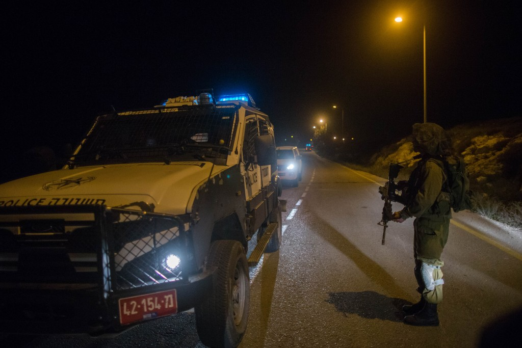 Israeli security near the Israeli settlement of Otniel, South Hebron Hills region where a Jewish woman in her 30's was killed in a stabbing attack in her home. (Yonatan Sindel/FLASH90)