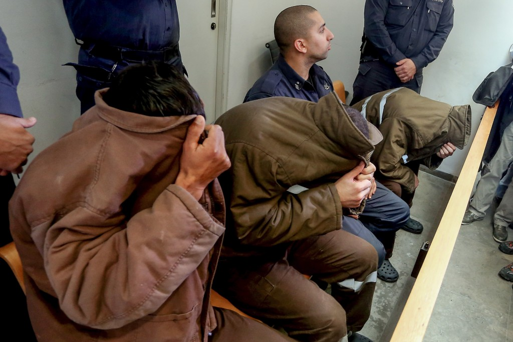 Three residents from the Israeli-Arab town of Arara, seen at the Haifa District Court on Wednesday,  were charged with helping Tel Aviv terrorist Nashat Melhem hide in Arara. (Basel Awidat/Flash90)