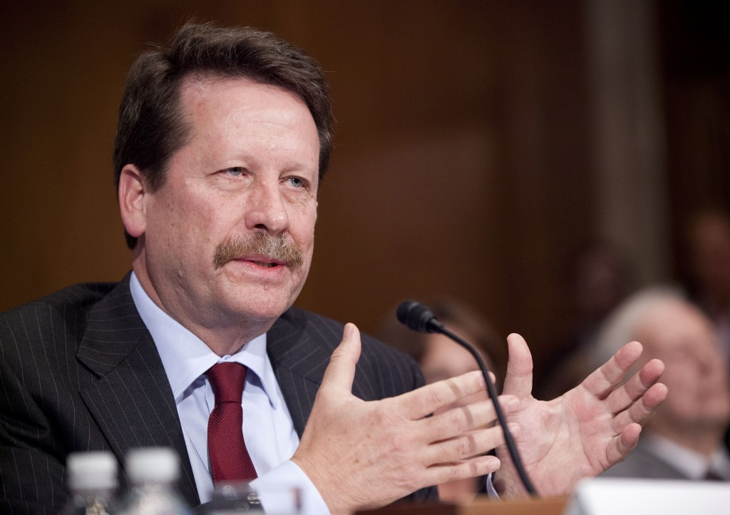 In this Nov. 17, 2015 photo, Dr. Robert Califf, President Barack Obama's nominee to lead the Food and Drug Administration, testifies on Capitol Hill in Washington. (AP Photo/Pablo Martinez Monsivais, File)