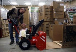 Troy-Bilt representative David Bowles assembles a snow blower at the Lowe's store in Kentlands, Maryland, on Thursday. All snow blowers were pre-sold and awaiting customer pick-up. (Gary Cameron/Reuters)