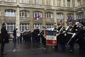 French President Francois Hollande (L) attends a ceremony during a visit to the French anti-terror security forces (Sentinelle) at Paris police headquarters, one year after the killings at the French satirical newspaper Charlie Hebdo, in Paris, France, January 7, 2016. France this week commemorates the victims of last year's Islamist militant attacks on satirical weekly Charlie Hebdo and a Jewish supermarket with eulogies, memorial plaques and another cartoon lampooning religion. REUTERS/Martin Bureau/Pool