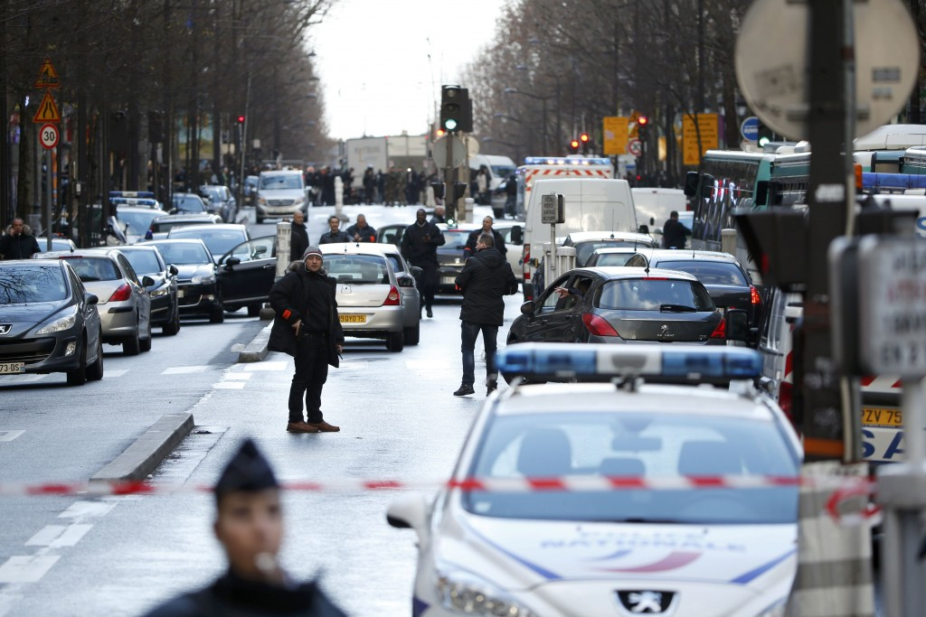 French police secure the area after a man was shot dead at a police station in the 18th district in Paris, France January 7, 2016. Police in Paris on Thursday shot dead a knife-wielding man who tried to enter a police station, police union sources said. The incident took place on the anniversary of last year's deadly Islamist militant attacks on the Charlie Hebdo satirical magazine in the French capital. REUTERS/Charles Platiau