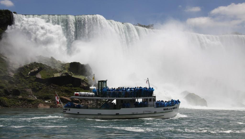 The Maid of the Mist tour boat sails at the base of the American Falls in Niagara Falls, NY. (AP Photo/David Duprey, File)