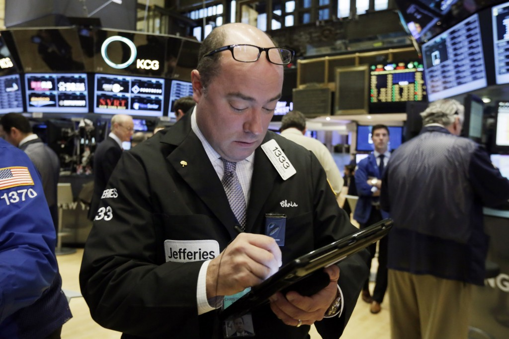 Trader Christopher Morie works on the floor of the New York Stock Exchange, Wednesday, Jan. 13, 2016. U.S. stocks are opening higher, led by gains in oil and gas companies as the price of crude turns higher. (AP Photo/Richard Drew)