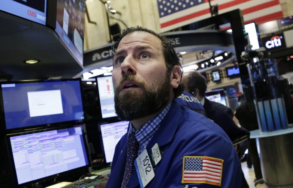 Michael Pistillo Jr. follows stock prices at the New York Stock Exchange on Friday. (AP Photo/Mark Lennihan)