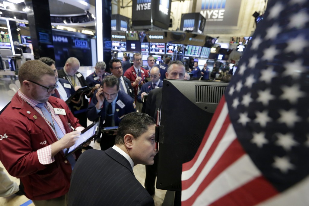Traders gather at a post on the floor of the New York Stock Exchange Tuesday. (AP Photo/Richard Drew)