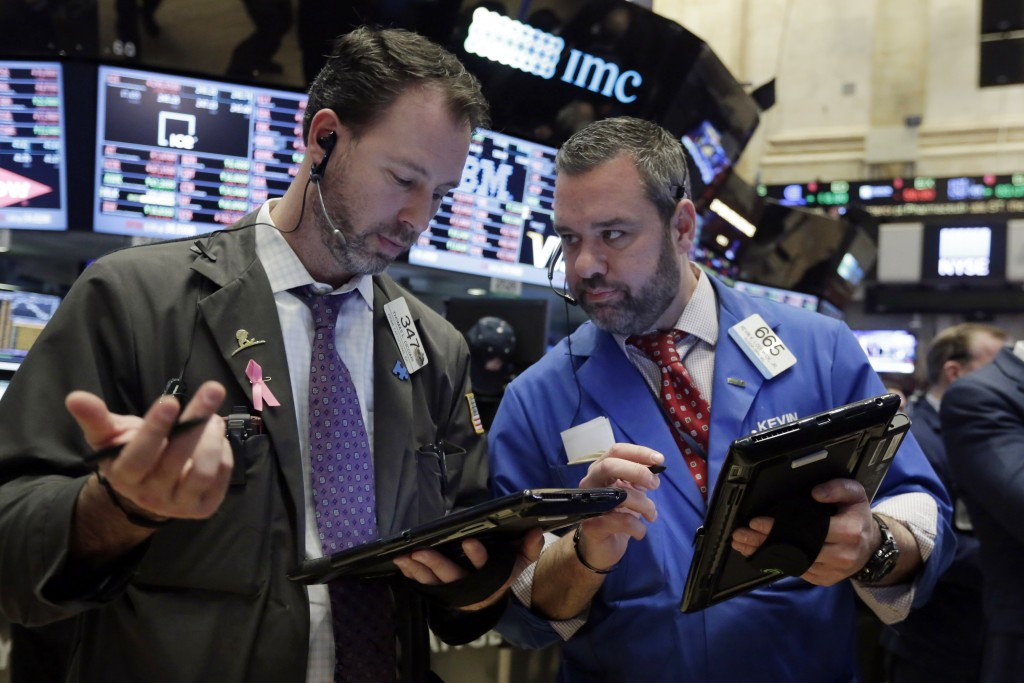 Traders Thomas Cicciari, left, and Kevin Lodewick work on the floor of the New York Stock Exchange on Wednesday. (AP Photo/Richard Drew)