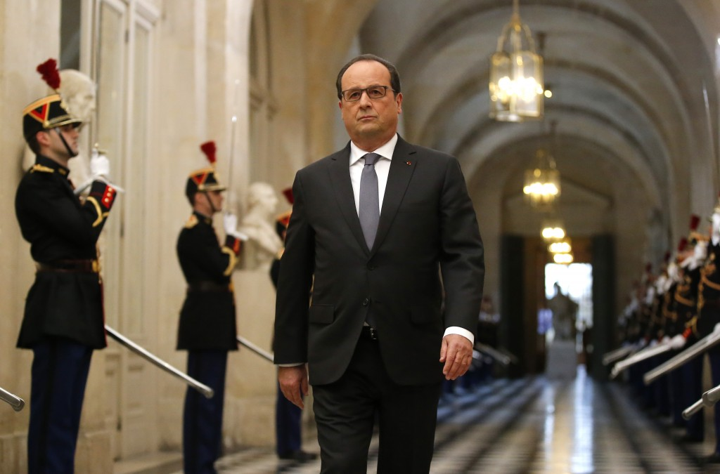 French President Francois Hollande arrives to deliver a speech at the Versailles castle, west of Paris, Monday, Nov.16, 2015. French President Francois Hollande is addressing parliament about France's response to the Paris attacks, in a rare speech to lawmakers gathered in the majestic congress room of the Palace of Versailles. (AP Photo/Michel Euler)