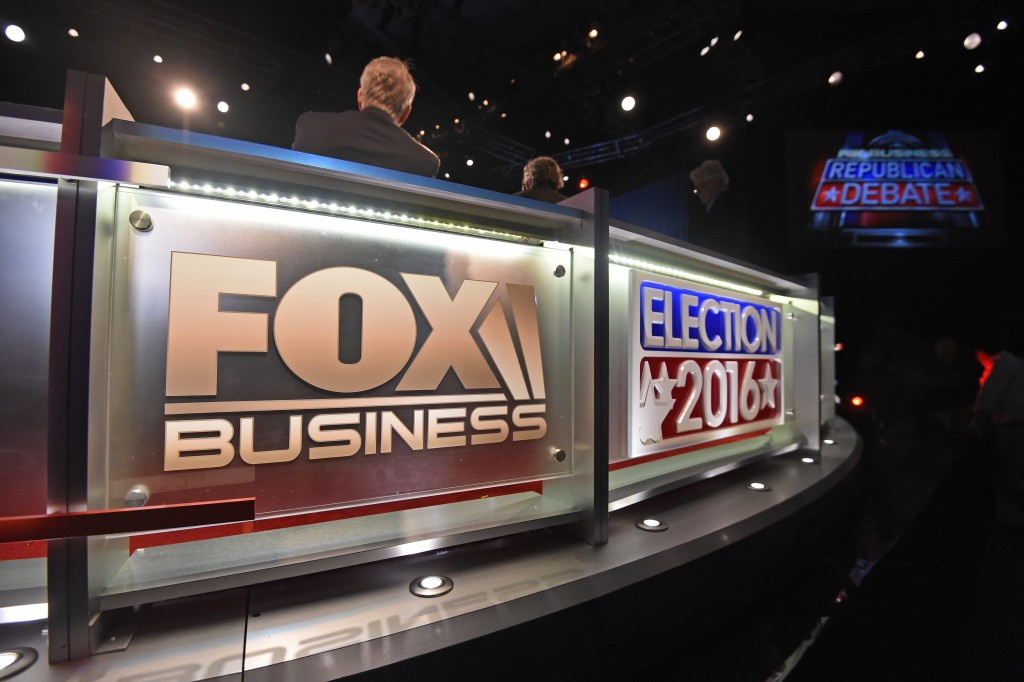 Dave Pregosin, right, lead stage manager, and Jeff Hark, left, director of production, sit in for moderators at the North Charleston Coliseum, Wednesday, Jan. 13, 2016, in North Charleston, S.C., in advance of Thursday's Fox Business Network Republican presidential debate. (AP Photo/Rainier Ehrhardt)