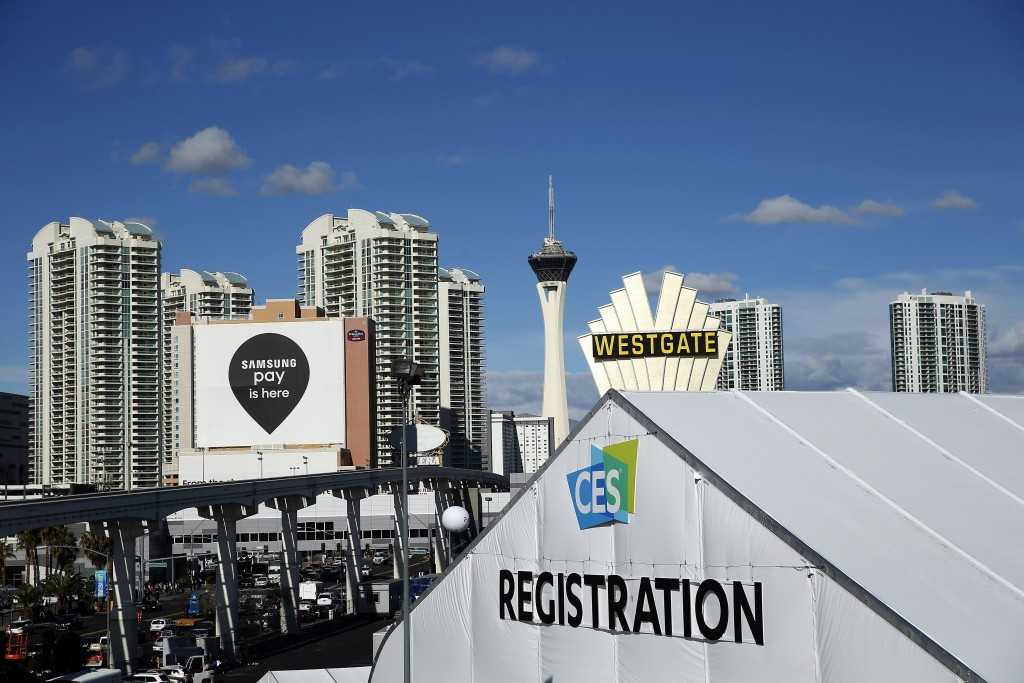 A CES International registration tent is seen against the Las Vegas skyline during the Consumer Electronics Show on Thursday. (AP Photo/John Locher)