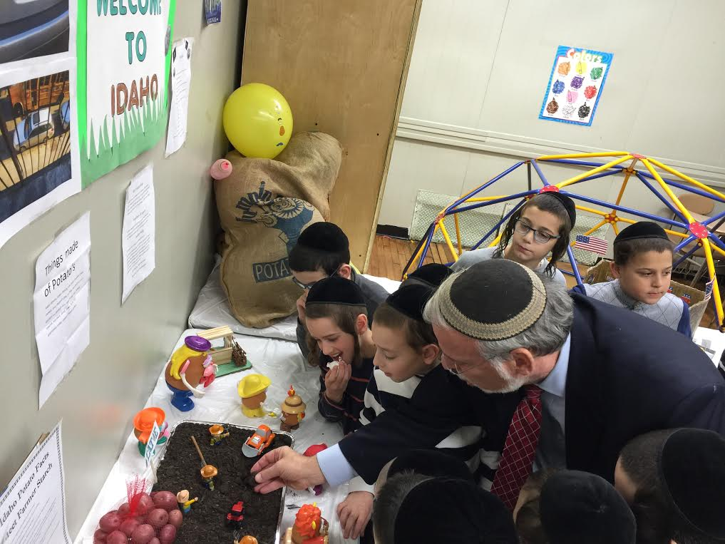 Assemblyman Dov Hikind (D-Brooklyn) attends a science fair at Talmud Torah Mevakshei Hashem to discuss the importance of science and education with students.