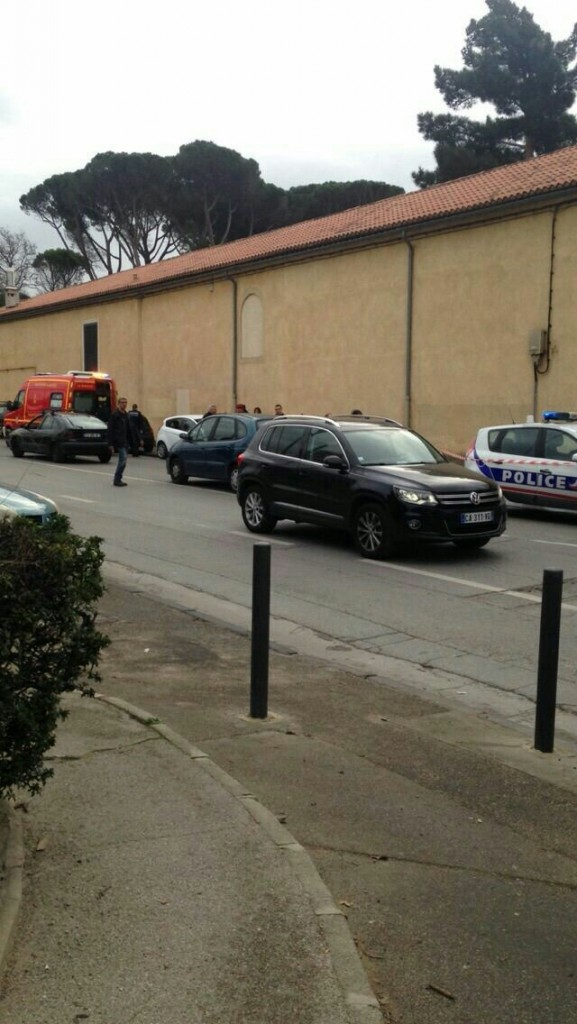 French police at the scene of the attack, near the shul. (Shimon Aronowitz)
