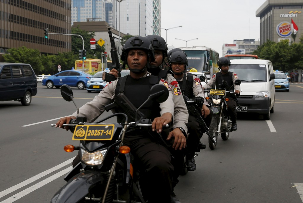 Indonesian policemen ride motorcycles as they patrol near the bomb blast site at Thamrin business district in Jakarta January 15, 2016. Indonesia must strengthen its defences against Islamic State and work with neighbouring countries to fight it, Jakarta's police chief said on Friday, a day after an attack by suicide bombers and gunmen in the heart of the Southeast Asian nation's capital. Just seven people were killed in the three-hour siege near a busy shopping despite multiple blasts and a gunfight, and five of them were the attackers themselves. REUTERS/Beawiharta