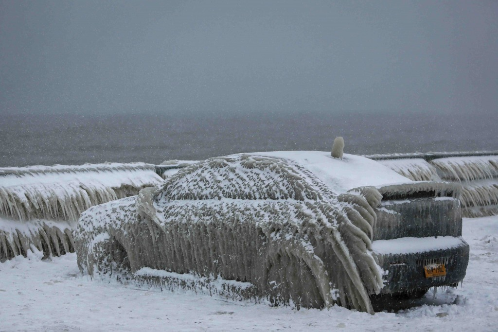 A car covered with ice was stranded on the waterfront in Hamburg, N.Y., since Sunday before it was freed from its frozen cage on Wednesday. (Lindsay DeDario/Reuters)