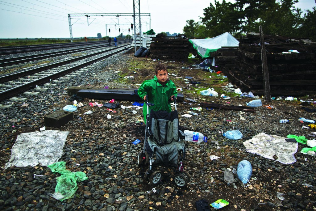 """Syrian refugee Radwan Shtaiwi, 8, poses for a picture while hoping to board a train in Tovarnik, Croatia. """"I just want to be with my dad again and my mother is a teacher and I wish she will find work and I can go to the same school with her,"""" he said.  (AP Photo/Muhammed Muheisen)"""