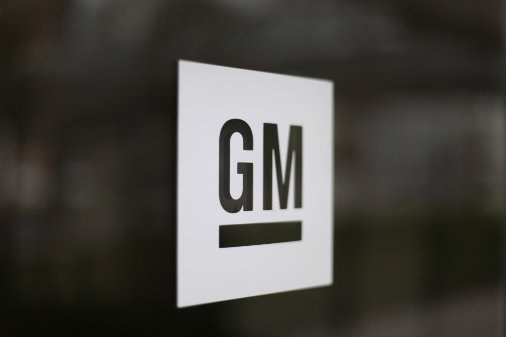 FILE - This Friday, May 16 2014, file photo, shows the General Motors logo at the company's world headquarters in Detroit. On Monday, Jan. 4, 2016, General Motors Co. announced it is investing $500 million in ride-sharing company Lyft Inc. GM gets a seat on Lyft's board as part of the partnership, which could speed the development of on-demand, self-driving cars. (AP Photo/Paul Sancya, File)