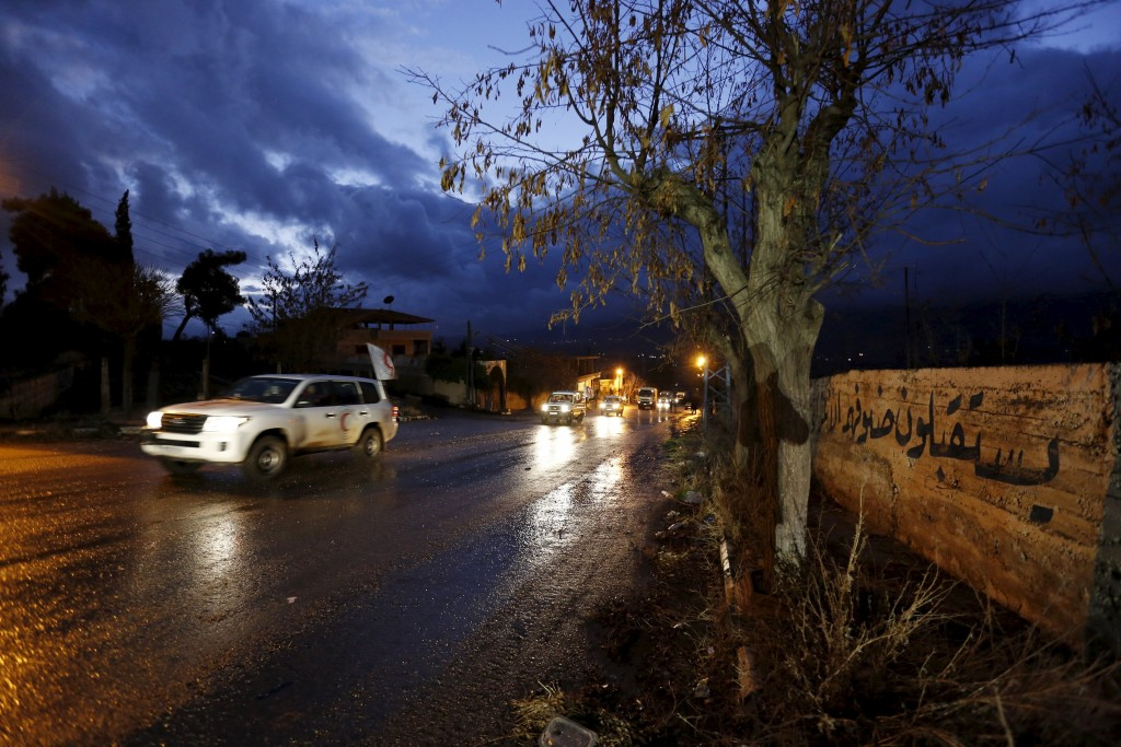 A Red Crescent aid convoy enters Madaya, Syria, January 14, 2016. Aid supplies on Thursday reached the besieged Syrian town and two trapped villages for the second time this week, raising hopes of further deliveries to help people dying of starvation. REUTERS/Omar Sanadiki