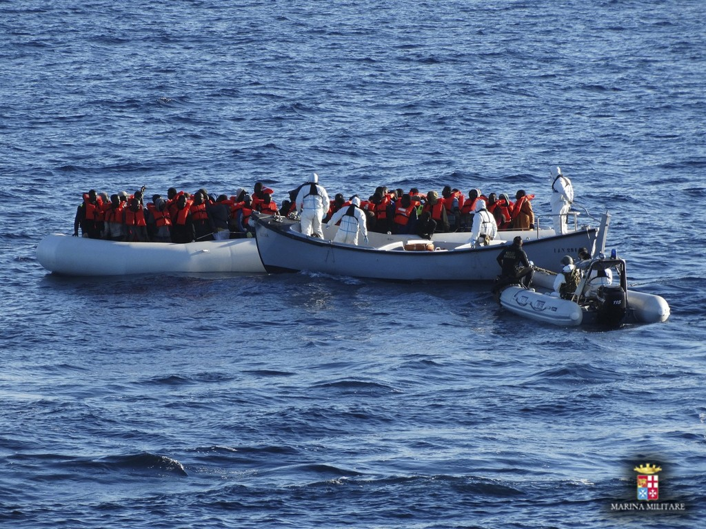 Migrants are rescued by the Italian Navy in the Mediterranean Sea, in this picture released on January 28, 2016 by Italian Navy. Italy's navy rescued 290 migrants and recovered six bodies from the water near a half-sunken rubber boat on Thursday, the first sea deaths recorded on the North Africa to Italy route this year, a spokesman said. REUTERS/Italian Navy/Handout via ReutersATTENTION EDITORS - THIS PICTURE WAS PROVIDED BY A THIRD PARTY. REUTERS IS UNABLE TO INDEPENDENTLY VERIFY THE AUTHENTICITY, CONTENT, LOCATION OR DATE OF THIS IMAGE. FOR EDITORIAL USE ONLY. NOT FOR SALE FOR MARKETING OR ADVERTISING CAMPAIGNS. THIS PICTURE IS DISTRIBUTED EXACTLY AS RECEIVED BY REUTERS, AS A SERVICE TO CLIENTS.