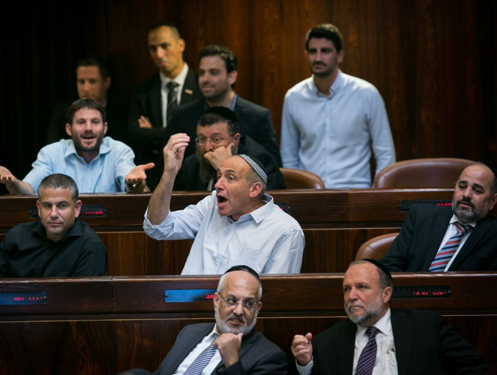Jewish Home MK Moti Yogev, shown here, at center, making a point during a Knesset session in October. (Miriam Alster/Flash90)