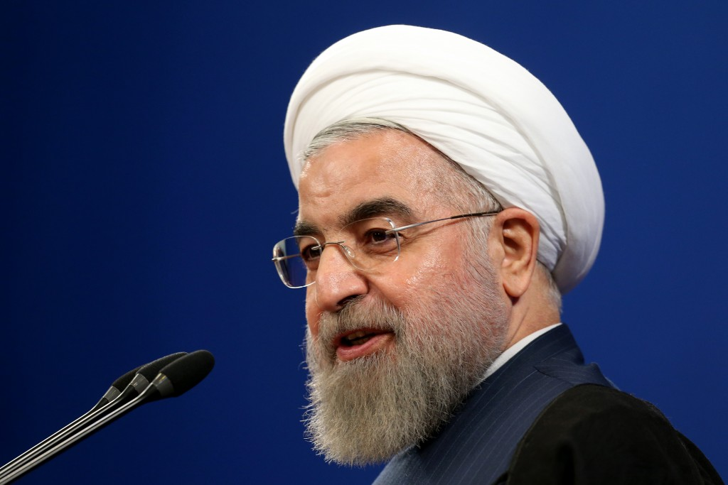 Iranian President Hassan Rouhani speaks during a press conference in Tehran, Iran, Saturday, Aug. 29, 2015. Rouhani said Saturday he opposed a parliamentary vote on the landmark nuclear deal reached with world powers, saying terms of the agreement will turn into legal obligation if it is passed by the house. (AP Photo/Ebrahim Noroozi)