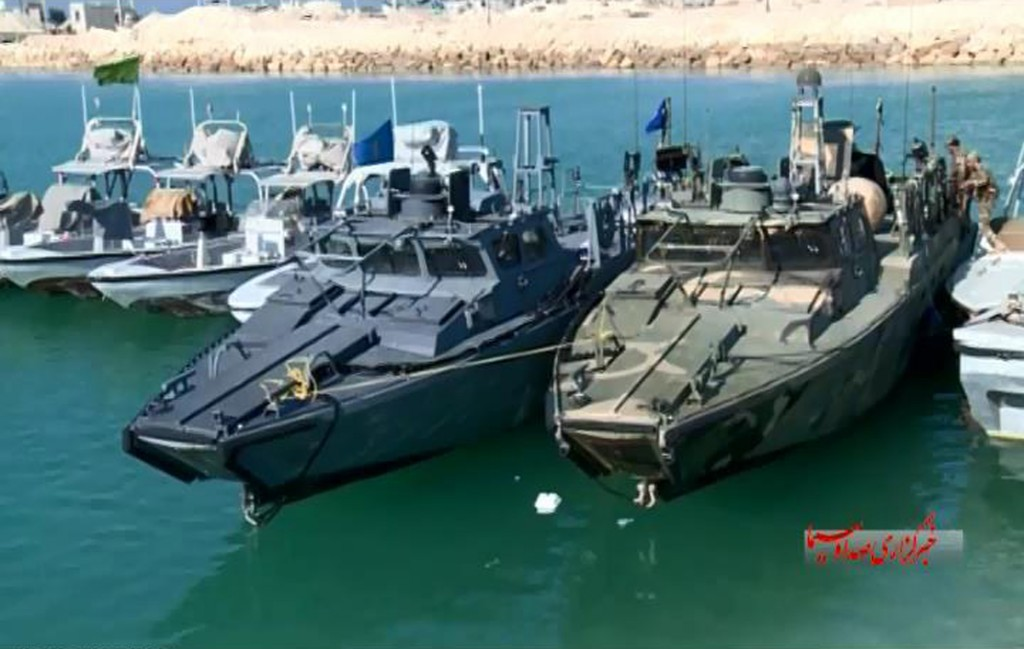 This screencap from video by the Iranian state-run IRIB News Agency shows American Navy boats in custody of the Iranian Revolutionary Guards in the Persian Gulf on Tuesday. (IRIB News Agency via AP)