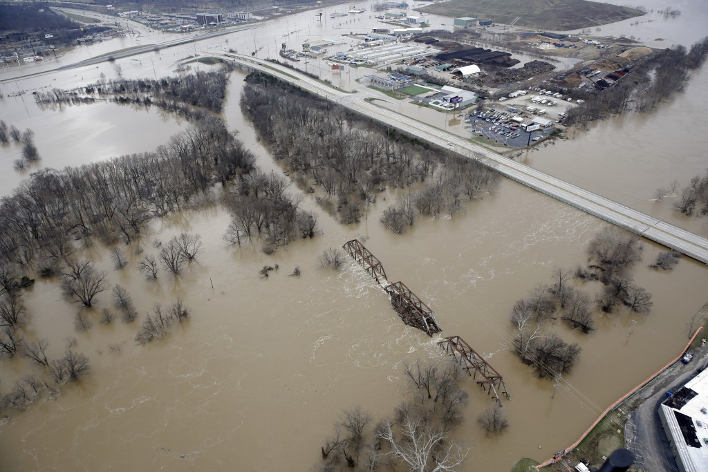 Flood water covers a railroad bridge where Interstate 44, top, meets Missouri Highway 141, right, in Valley Park, Mo. on Wednesday. (AP Photo/Jeff Roberson)