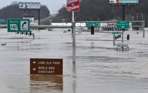 Floodwater from the Meramec River surrounds signs at the intersection of I-44 and Highway 141 in southwest St. Louis County on Wednesday. (J.B. Forbes/St. Louis Post-Dispatch via AP)