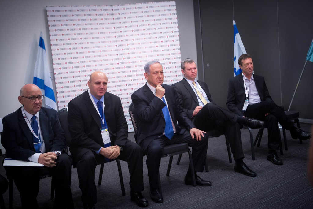 Israeli Prime Minister Binyamin Netanyahu and cybertech leaders at a forum at the Cybertech Israel Conference and Exhibition in Tel Aviv on Tuesday. (Miriam Alster/Flash90)