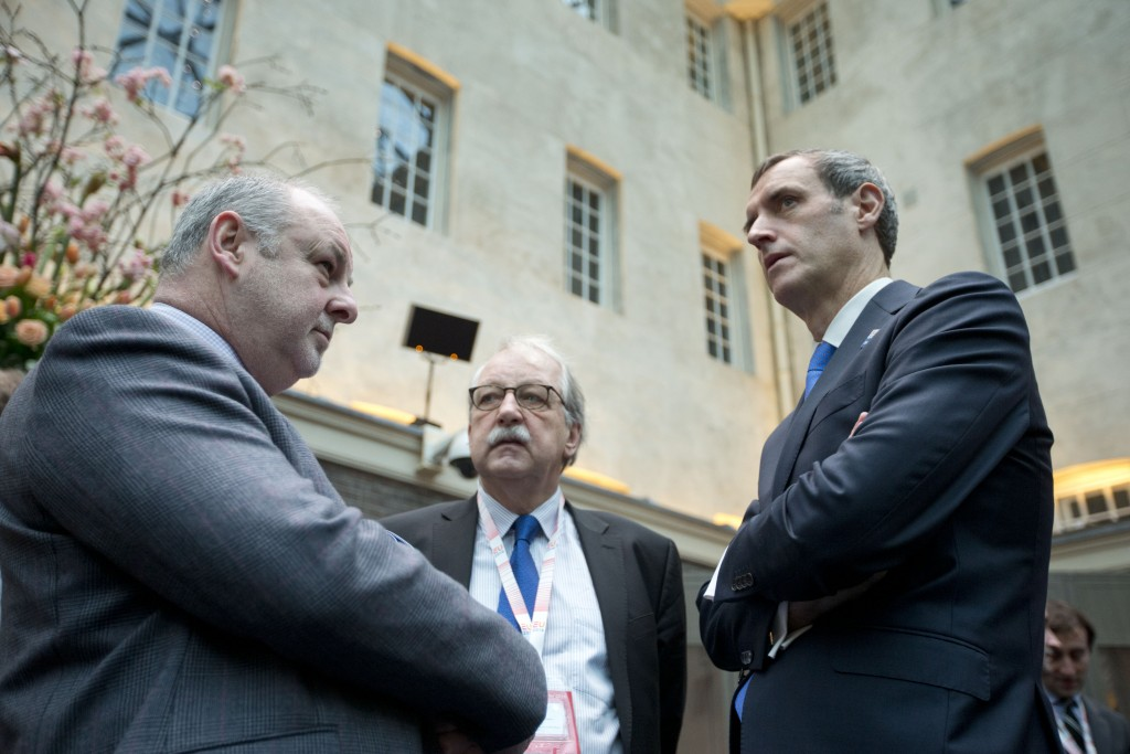 Europol director Rob Wainwright, right, talks to Matthias Ruete, center, director of the European Commission's Migration and Home Affairs department during an informal meeting of EU Justice and Home Affairs ministers at the Maritime Museum in Amsterdam, Netherlands, Monday, Jan. 25, 2016. European Union justice and interior ministers have started urgent discussions on how to tackle the migrant crisis amid the stream of new arrivals and continuing disagreements over how to seal off borders. (AP Photo/Peter Dejong)