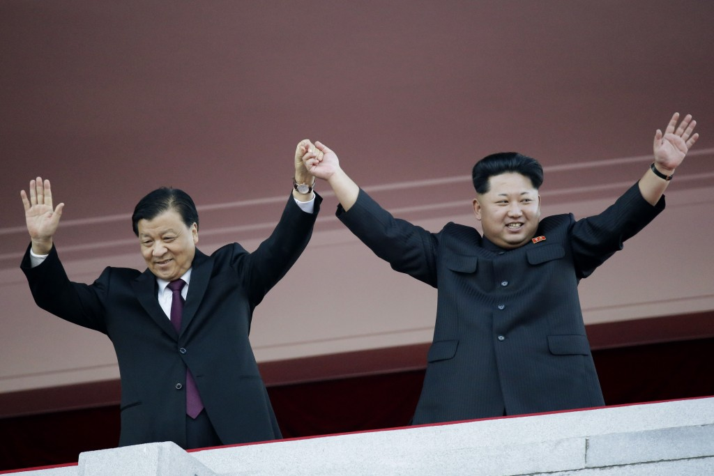In this Oct. 10, 2015, file photo, North Korean leader Kim Jong Un, right, joins hands and waves with visiting Chinese official Liu Yunshan, the Communist Party's fifth-ranking leader, during a parade in Pyongyang, North Korea. China sees North Korea's claim to have conducted its first hydrogen bomb test on Wednesday, Jan. 6, 2016, as yet another act of defiance, boding ill for a relationship already under strain. (AP Photo/Wong Maye-E, File)