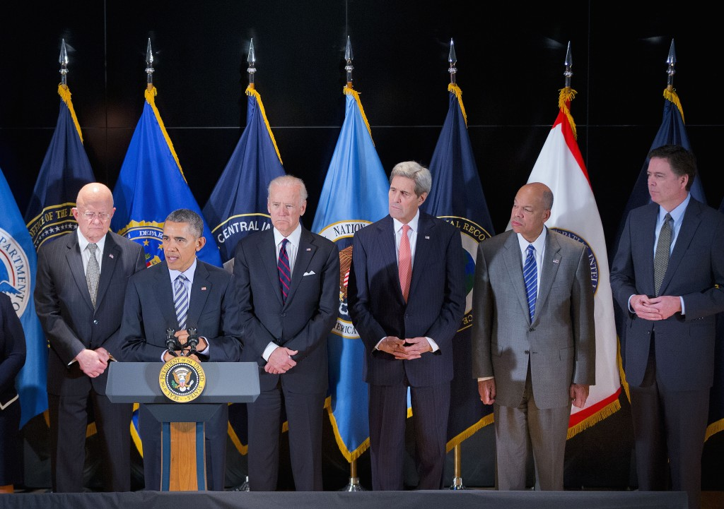 President Barack Obama speaks at the National Counterterrorism Center in McLean, Va.,Thursday, Dec. 17, 2015. Joining him on stage, from left are, National Counterterrorism Center Director Nicholas Rasmussen, Attorney General Loretta Lynch, Office of National Intelligence Director James Clapper, Vice President Joe Biden, Secretary Of State John Kerry, Homeland Security Secretary Jeh Johnson, and FBI Director James Comey. (AP Photo/Pablo Martinez Monsivais)