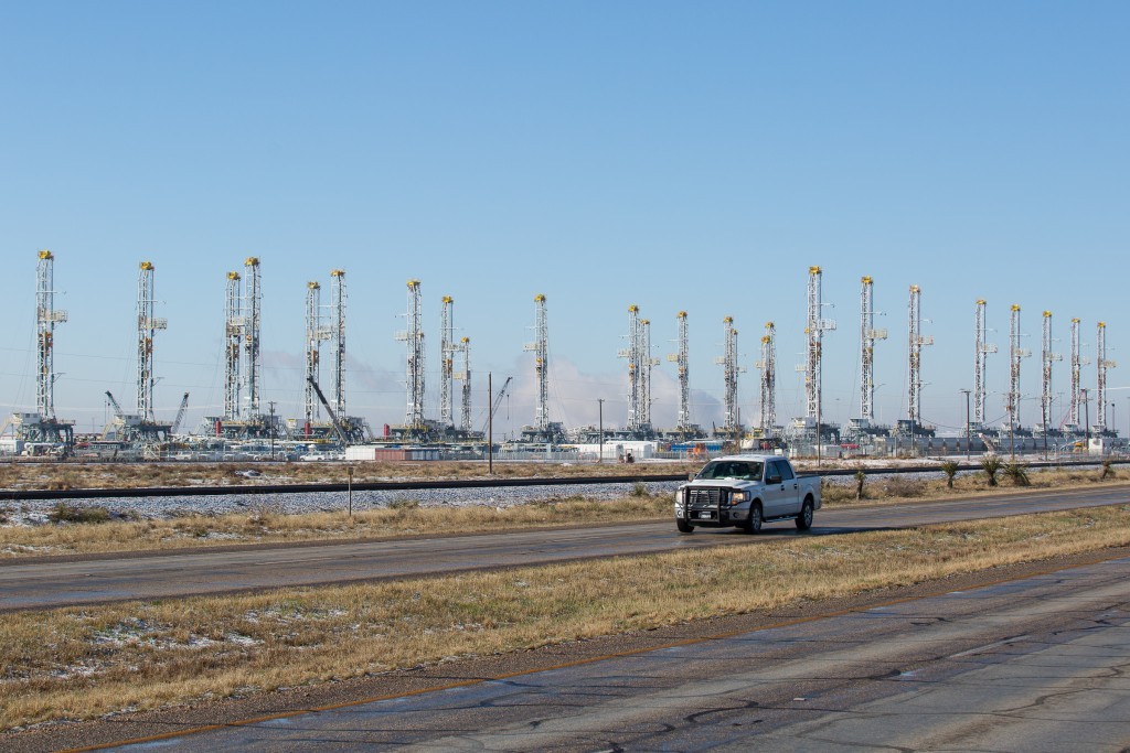 In this file photo, more than 30 oil drilling rigs are idle in a Helmerich & Payne, Inc. yard in Odessa, Texas, along Highway 80. (Courtney Sacco/Odessa American via AP) MANDATORY CREDIT