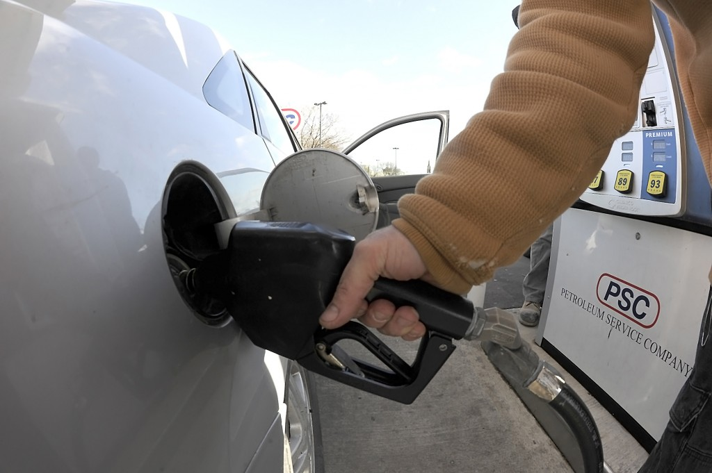 A motorist takes advantage of gas costing less than $2 a gallon at a Petroleum Service Corporation gas station in Wilkes-Barre, Pa. . (Mark Moran/The Citizens' Voice via AP)