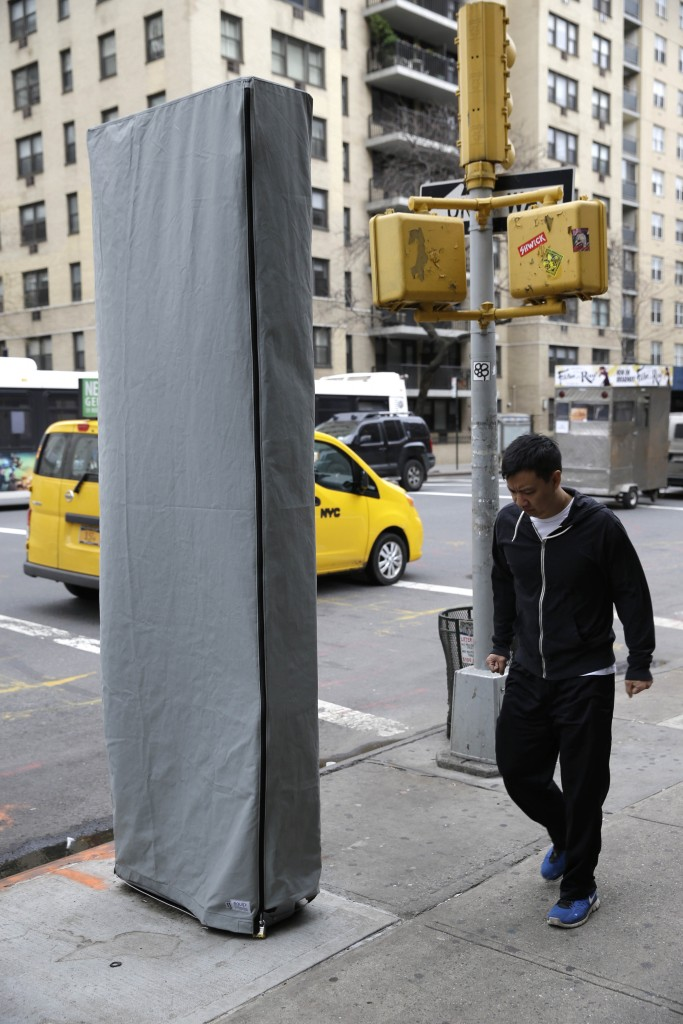 A covered wireless kiosk at a New York intersection on Dec. 31, signaling a plan to turn payphones into what's billed as the world's biggest and fastest municipal wi-fi network. (AP Photo/Seth Wenig)