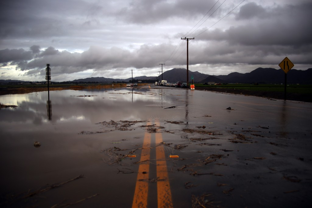 Water covers a closed Las Posas Road near Camarillo, Calif., after heavy rain from the first in a series of El Nino storms passed over the area on Wednesday, Jan. 6, 2016. (AP Photo/Joel Angel Juárez)