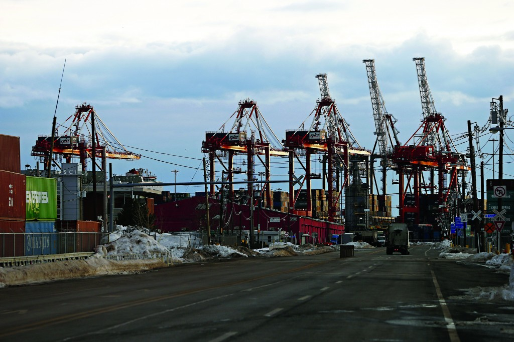 Cranes sit idle Friday at Port Newark in Newark, N.J., as longshoremen walked off the job. (AP Photo/Rich Schultz)