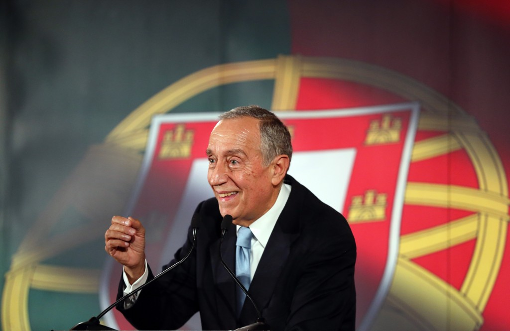 In this picture taken Jan. 20, 2016, Marcelo Rebelo de Sousa smiles while addressing supporters during his presidential election campaign in Lisbon. A poll published Friday, Jan. 22, 2016, in weekly Expresso suggested Rebelo de Sousa, a veteran center-right politician who became a popular television personality, will collect more than 50 percent of votes against nine rivals in the Jan. 24 Portuguese presidential election. In Portugal the president has no executive power, which is held by the government, but is an influential voice. (AP Photo/Armando Franca)