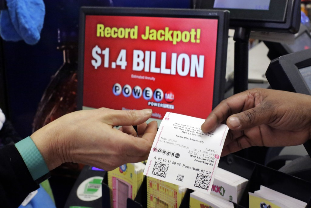 A Powerball ticket is sold in a truck stop in Carlisle, Pa. (AP Photo/Gene J. Puskar)