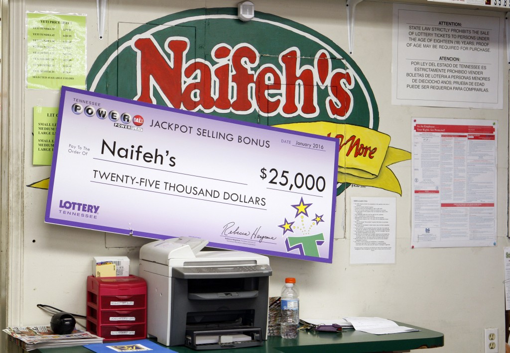 The check for the merchant's share of the winnings sits in Naifeh's Grocery in Munford, Tenn., Thursday, Jan. 14, 2016. One of the winning Powerball tickets in Wednesday's record jackpot drawing of $1.6 billion was sold at the store. (AP Photo/Karen Pulfer Focht)