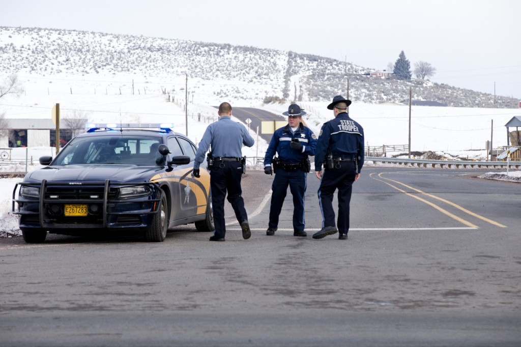 Oregon State Police man a roadblock at the intersection of highways 395 and 20 outside of Burns, Ore., Wednesday morning, Jan. 27, 2016. Authorities were restricting access on Wednesday to the Malheur National Wildlife Refuge headquarters being occupied by an armed group after one of the occupiers was killed during a traffic stop and eight more, including the group's leader Ammon Bundy, were arrested. (Dave Killen/The Oregonian via AP) MAGS OUT; TV OUT; NO LOCAL INTERNET; THE MERCURY OUT; WILLAMETTE WEEK OUT; PAMPLIN MEDIA GROUP OUT; MANDATORY CREDIT