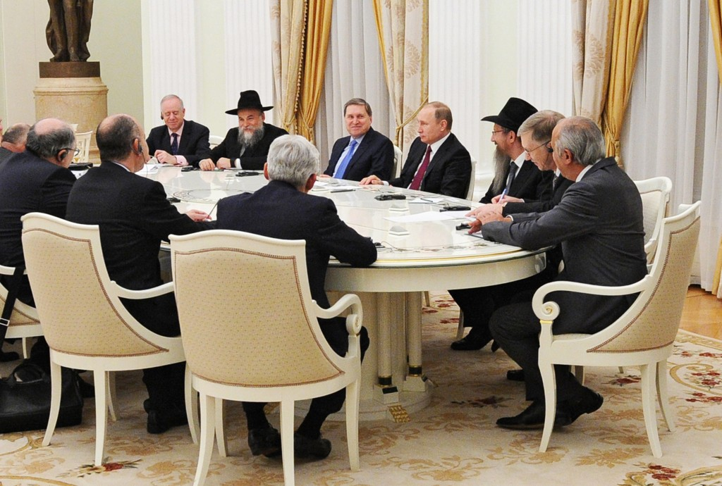 Russian President Vladimir Putin, fourth right, meets with representatives of the European Jewish Congress in the Kremlin in Moscow, Russia, Tuesday, Jan. 19, 2016. (Mikhail Klimentyev/Sputnik, Kremlin Pool Photo via AP)
