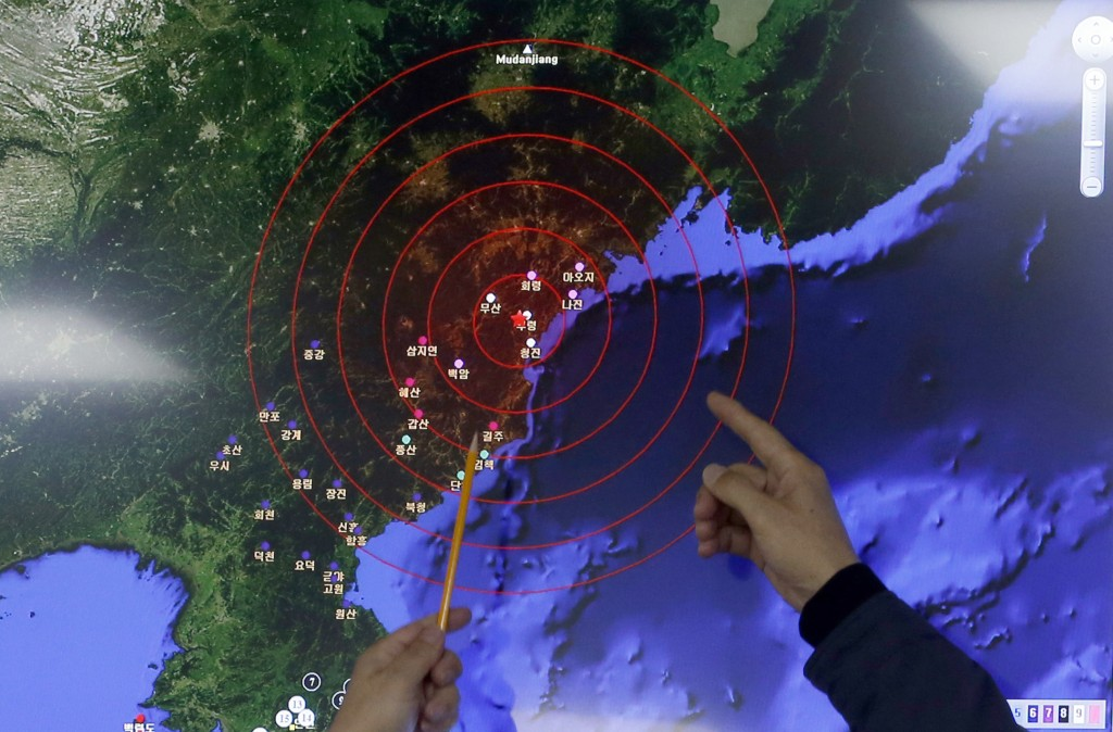 Officers from the Korea Meteorological Administration point at the epicenter of seismic waves in North Korea, at the National Earthquake and Volcano Center of the Korea Meteorological Administration in Seoul, South Korea, on Wednesday. (AP Photo/Lee Jin-man)