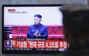 A South Korean soldier watches a TV broadcast showing a file image of North Korean leader Kim Jong Un, at the Seoul Railway Station in Seoul, South Korea, on Wednesday. (AP Photo/Ahn Young-joon)